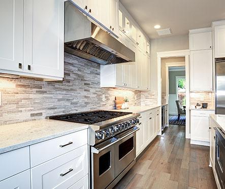 Luxury white kitchen with large kitchen island.